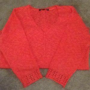 Orange ladies sweater.