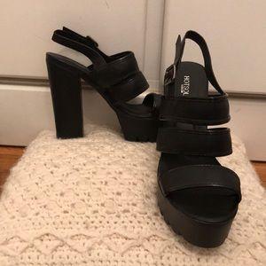 Strappy unworn heels