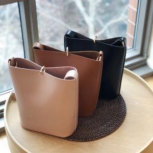Handbags - Minimal metal closure bucket bag(pouch inside)