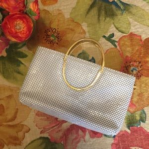 Handbags - Clutch with reversible handles