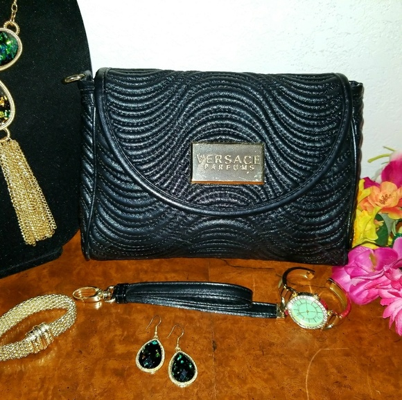 f3d1251fdf6f Versace Quilted Leather Clutch