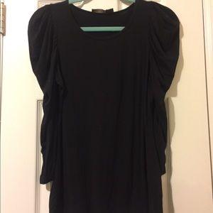Soft black long sleeve with ruffled sleeves.