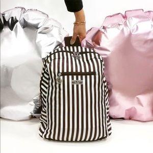 Barely used Henri Bendel Zip Packable backpack