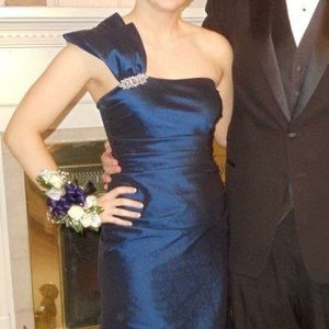 One shoulder gown featuring beautiful brooch!