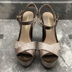 Platforms snake skin heels