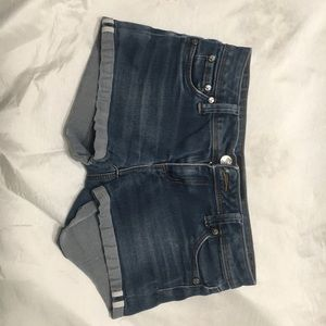 Dark wash denim shorts.
