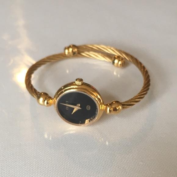 171b2ba041e Gucci Accessories - Vintage GUCCI 2700L Twisted Cable Bangle Watch