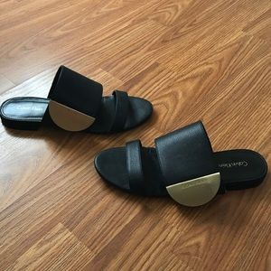 Black and gold Calvin Klein sandals