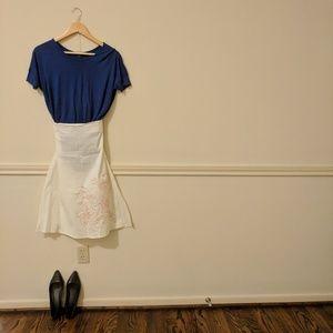 Dresses & Skirts - Pretty white A-line skirt w/glittery floral design
