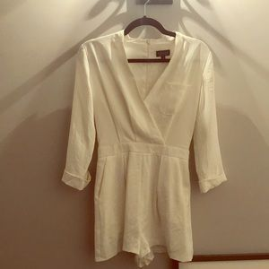 Adorable white romper from Topshop. SIZE US 2