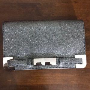 Ivanka Trump Metallic clutch
