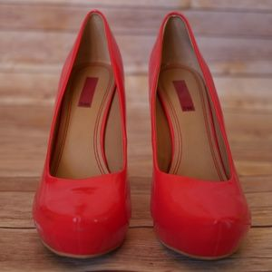 Patent leather platform heels in bright coral