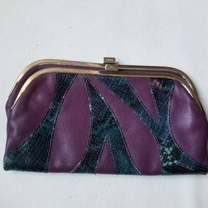 100% Leather clutch
