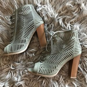 Olive heeled lace up booties with cutout detail