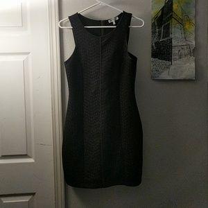 Form fitting, black spandex/cotton dress
