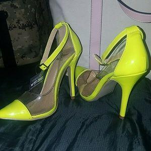 Shiekhshoes neon yellow heels.