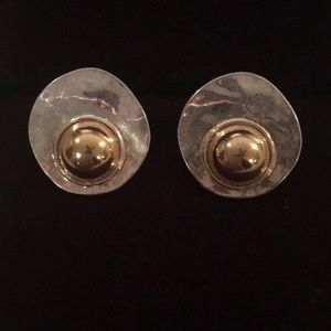 Jewelry - Silver and gold pierced earrings.