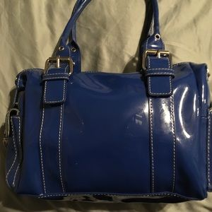 Hype shiny blue bag with pop of green interior
