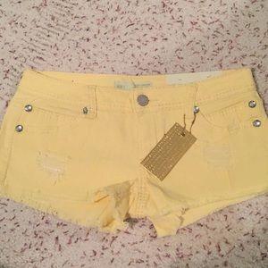 Yellow denim shorts
