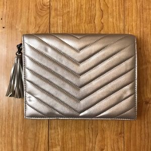 Make an offer! NWOT Neiman Marcus Silver Clutch