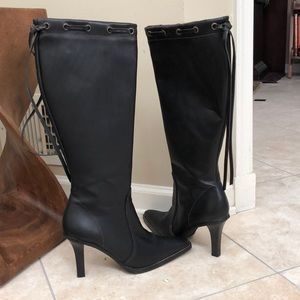 Black, high leather boots by coach
