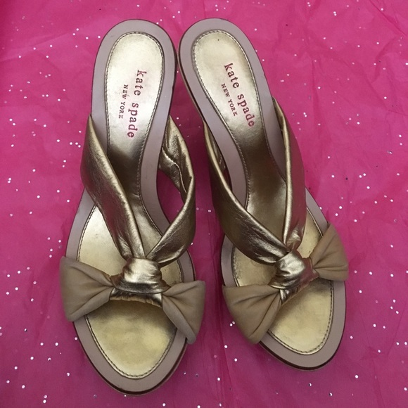 kate spade Shoes - Kate Spade Gold bow wooden wedge sandals