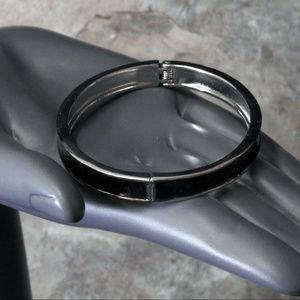 NWOT silver with black color bracelet.  LTDB91nc