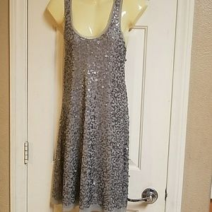 Grey / silver sparkly dress.