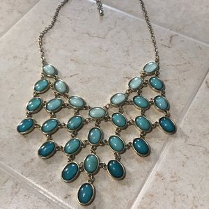 Tiered teal green stone and gold necklace