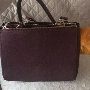Burgundy purse with purse charm