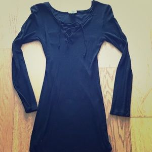 Long sleeve form fitting little black dress!
