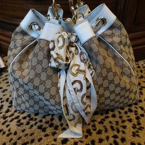 Gucci Classic print with scaft tote.