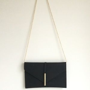 Midnight black clutch with gold chain strap