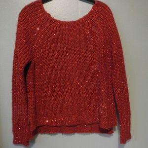 Sparkly red sweater by Jennifer Lopez