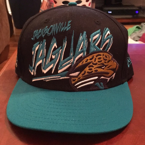NWOT THROWBACK JACKSONVILLE JAGUARS SNAPBACK HAT.  M 5a2b2aceb4188e10db0457b9. Other Accessories ... b859d75ef