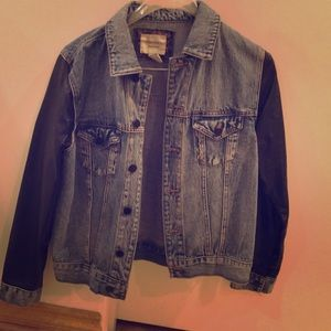 Jean jacket with faux leather sleeves.