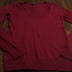 The limited maroon V-neck sweater size xs