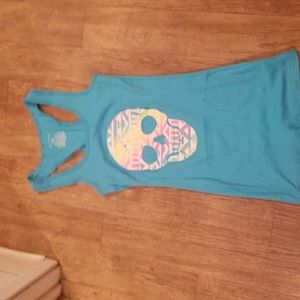 Blue wife beater with a rainbow colored skull