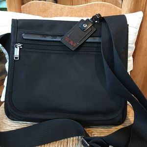 Tumi pocket bag small new without tags