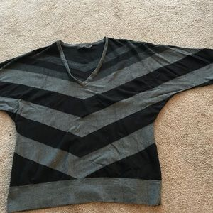 Gray and black striped sweater with banded bottom