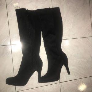 Knee high black suede heeled boots