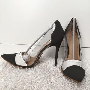 Dark grey heels with clear pvc sides.