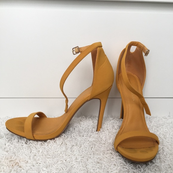 30682f00a12 Mustard yellow strappy high heel sandals
