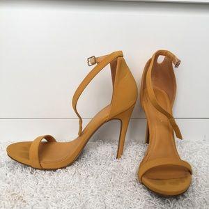 Mustard yellow strappy high heel sandals
