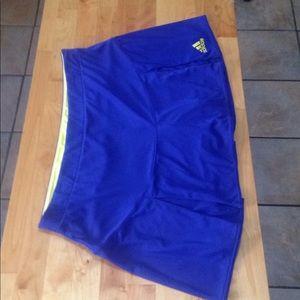Adidas blue/yellow skort, size Large.