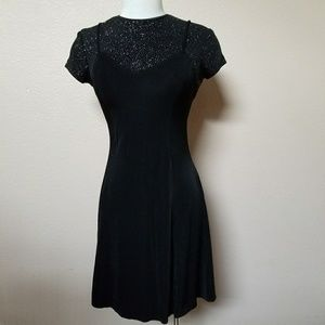 Vintage black slinky fit skater mini dress