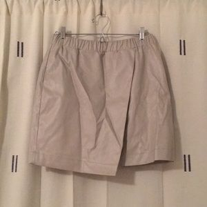 Off-white faux-leather asymmetrical miniskirt