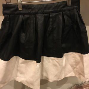 Black + White pleather mini skirt