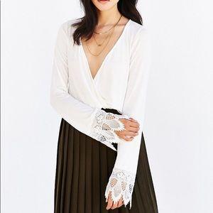 UO white crochet bell sleeve top