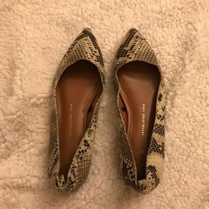Snakeskin pointed flats